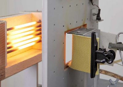 A machine testing the heat resistance of a piece of textile