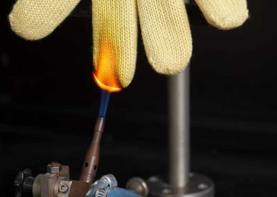 A glove put in contact with a flame